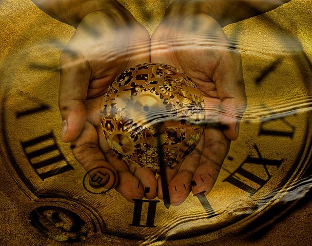 abstract hands holding clockwork world over background of clock face